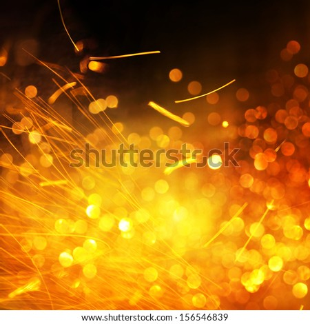 Bokeh and Sparks Fire and Light Background - stock photo