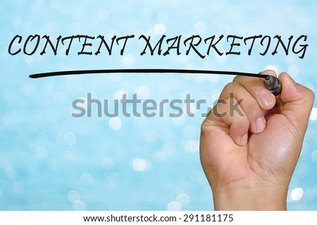 bokeh background and hand writing content marketing. - stock photo