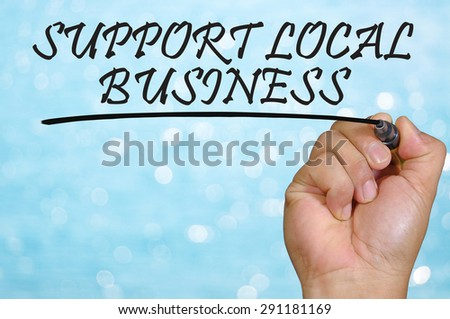bokeh background and hand writing support local business. - stock photo