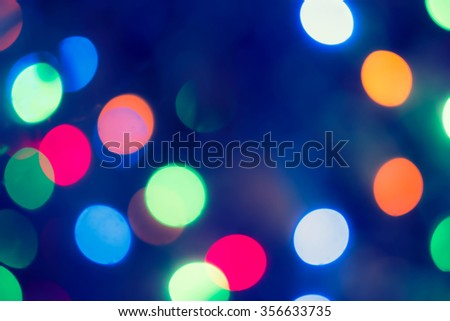 Bokeh Background with a lot of copy space.  Holiday glowing Abstract Defocused Background With Blinking lights. Blurred Bokeh. Retro Color Vintage toned photo - stock photo