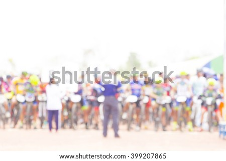 Bokeh blur of a mountain bike race. - stock photo