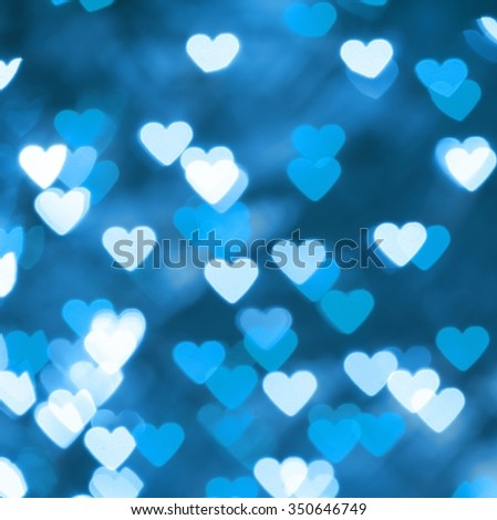 Bokeh blurred background of blue lights in the shape of heart. - stock photo