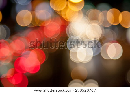 Bokeh blurring of car lights at night on the road.