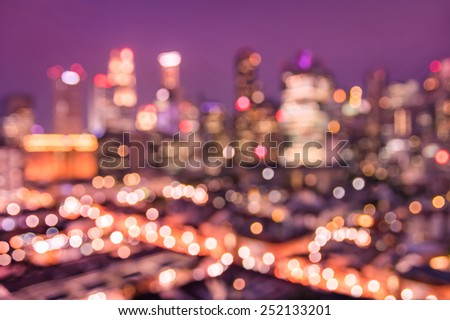 Bokeh filter of Singapore skyline from above during the blue hour - Asian modern city scape with spectacular nightscape panorama - Blurred defocused night lights on a violet marsala filtered editing - stock photo