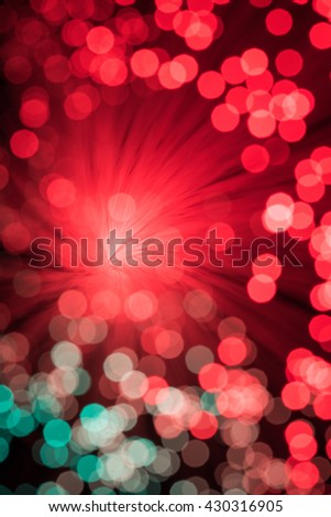 Bokeh from defocussed red lights from a fibre optic lamp