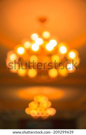 Bokeh from yellow lamps on ceiling  - stock photo