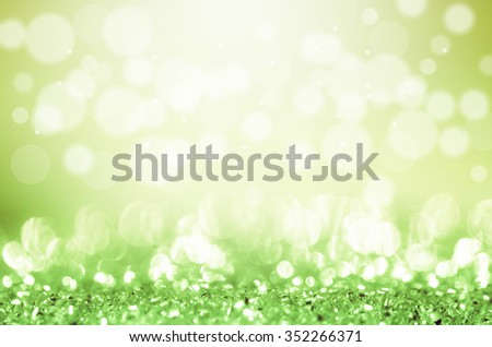 bokeh in green and yellow light tones abstract background.