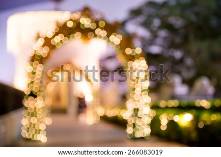 Bokeh light background of beautiful wedding garden at night / color tone tuned - stock photo