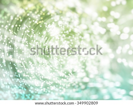 Bokeh light, shimmering blur spot lights on blue and green abstract background. - stock photo