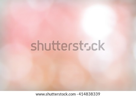 Bokeh light spots on pink blurred background