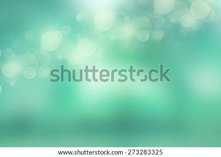 Bokeh lights on fresh mint green background - stock photo