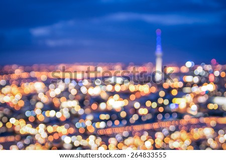 Bokeh of Auckland skyline from Mount Eden after sunset during the blue hour - New Zealand modern city with spectacular nightscape panorama - Blurred defocused night lights - stock photo