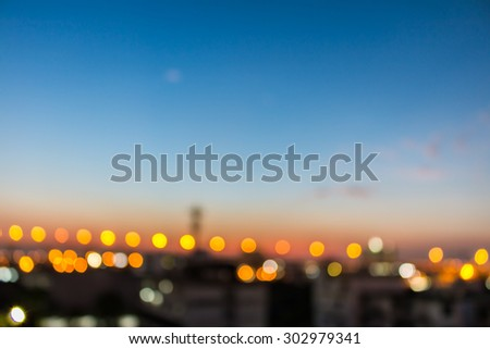 bokeh of city and bridge before sunset background - stock photo
