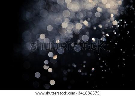 bokeh of lights on black background - stock photo