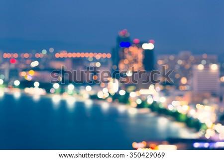 Bokeh of pattaya city at night. - stock photo