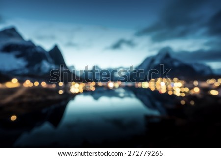 bokeh (out of focus) of sunset  in Reine Village, Lofoten Islands, Norway - stock photo