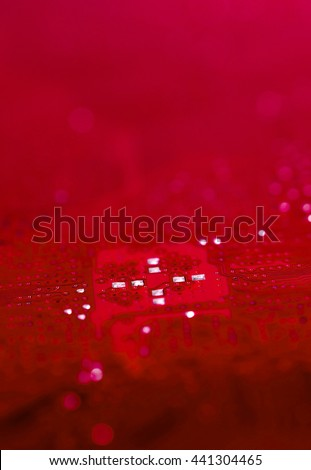 bokeh red pcb motherboard chip microchip integrated circuit board pattern background with copy-space - stock photo
