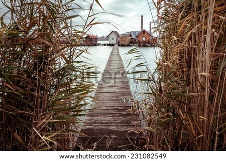 Bokod lake with pier and fishing huts - stock photo