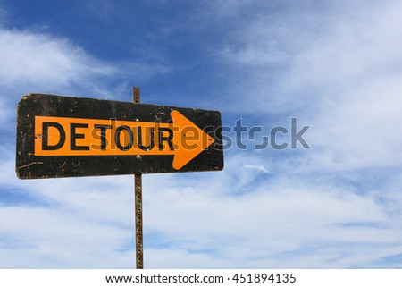 bold detour sign with wispy clouds in summer sky background - stock photo