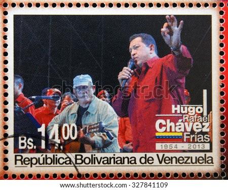 BOLIVARIAN REPUBLIC OF VENEZUELA - CIRCA 2013: A stamp printed in Venezuela shows Hugo Rafael Chavez (1954-2013), President of Venezuela, circa 2013  - stock photo