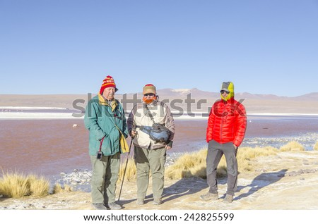 Bolivia, Antiplano: Tourists family visiting Laguna Colorada - stock photo