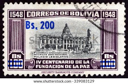 BOLIVIA - CIRCA 1957: A stamp printed in Bolivia shows Legislative Palace, circa 1957. - stock photo