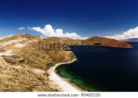 Bolivia - Isla del Sol on the Titicaca lake, the largest high altitude lake in the world (3808m) This island's legendary Inca creation site and the birthplace of the sun. Landscape of the Titicaca lake - stock photo