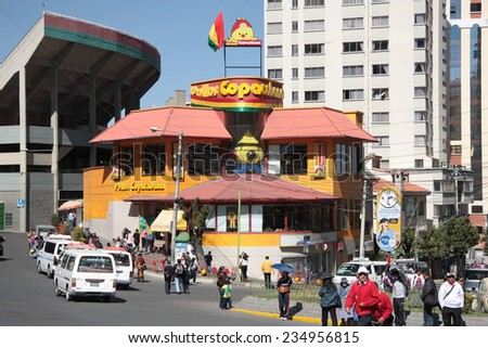 BOLIVIA, LA PAZ, 13 AUGUST 2013 - People at Famous Pollos Copacabana fast food restaurant sign in La Paz, Bolivia, South America - stock photo