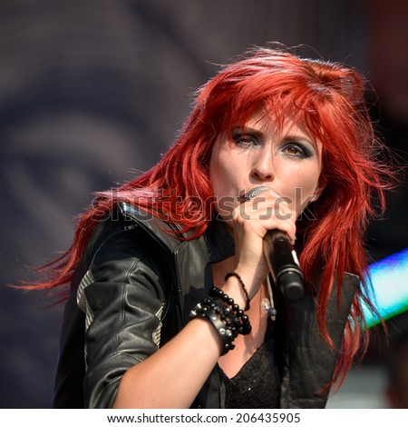 BOLKOW, POLAND - JULY 19, 2014: Agnieszka Lesna during concert band Desdemona ate the Castle Party dark independent festival. Castle  Party is annual festival with the gothic, rock and electro music.  - stock photo