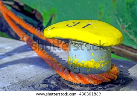 bollard with mooring line of a trawler  - stock photo