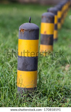 bollards in grassland - stock photo
