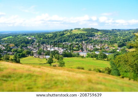 Bollington in Cheshire, England. Former cotton mill town with a former mill in the centre of the image. Miniature effect used to draw attention to the centre of the image. - stock photo