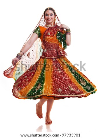 Bollywood dancer in traditional beautiful orange dress in movement - stock photo