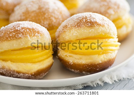 "Bolo de Berlim, or ""Berlin Balls"": Portuguese Fried Dough Rolled in Sugar and Filled With Ovos Moles - stock photo"