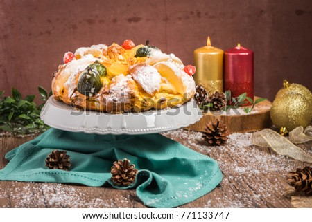 Bolo do Rei or King's Cake, Made for Christmas, Carnavale or Mardi Gras with Present Wrapping in Background