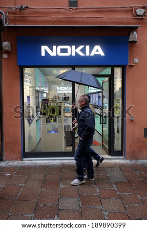 BOLOGNA, ITALY - APRIL 19, 2014: Pedestrians walk past a Nokia mobile telephone retail store in Bologna, Italy, on Saturday, April 19, 2014.  - stock photo