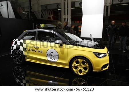 BOLOGNA - ITALY-DEC 4: Bologna Motor Show audi yellow checkered on December 04, 2010 in Bologna Italy - stock photo