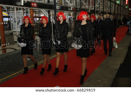 BOLOGNA ITALY-DEC 4: Bologna Motor Show ducati girls. on December 04, 2010 in Bologna Italy - stock photo