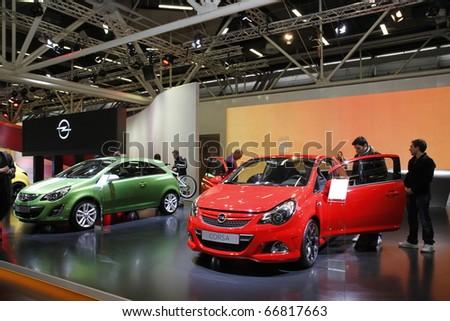 BOLOGNA ITALY-DEC 4: Bologna Motor Show opel corsa red on December 04, 2010 in Bologna Italy - stock photo