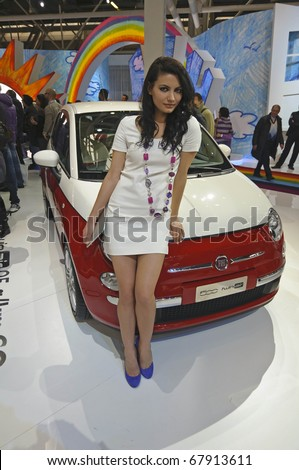 BOLOGNA, ITALY - DECEMBER 8: Bologna Motor Show on December 08, 2010 in Bologna, showing Fiat 500 Twin Air with Fashion Model