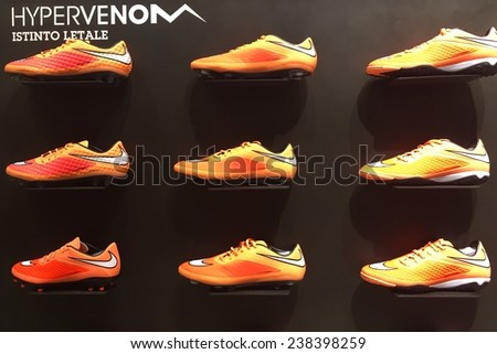 BOLOGNA, ITALY - DECEMBER 11, 2014: Exposition of nike sport shoes. Nike is one of the world's largest suppliers of athletic shoes and apparel. The company was founded on January 25, 1964.  - stock photo