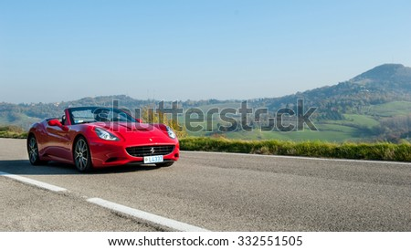 BOLOGNA, ITALY - DECEMBER 8, 2013: Ferrari California Sports car on the hills of Bologna. The Ferrari California is a grand touring 2+2 sports car produced by the Italian manufacturer Ferrari. - stock photo