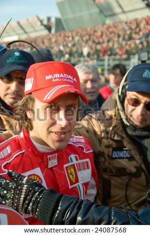 BOLOGNA,ITALY-06 DECEMBER: luca badoer ,ferrari's official test driver interviewed by television at the 2008 edition of Motor Show in Bologna,Italy