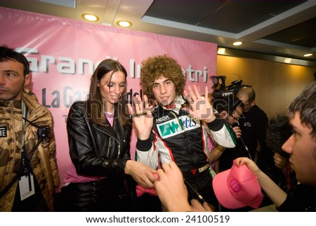 BOLOGNA,ITALY- DECEMBER 7: The new 250cc motorbik champion Marco Simoncelli meets his fan at the Motorshow on December 7, 2008 in Bologna, Italy.