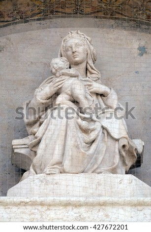 BOLOGNA, ITALY - JUNE 04: Madonna and Child with Saints, Lunette of San Petronio Basilica by Jacopo della Quercia in Bologna, Italy, on June 04, 2015