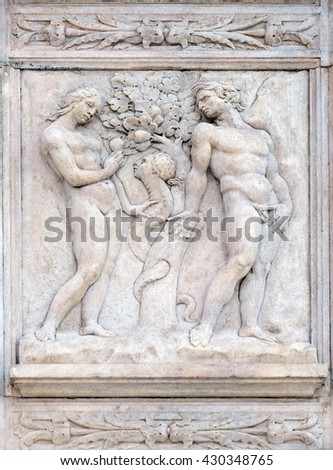 BOLOGNA, ITALY - JUNE 04: Temptation, Genesis relief on portal of Saint Petronius Basilica in Bologna, Italy, on June 04, 2015 - stock photo