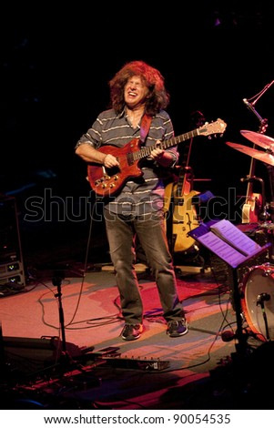 "BOLOGNA, ITALY - NOV 12: ""Pat Metheny"" [Jazz Guitarist] playing wood acoustic guitar  near the battery at Bologna Jazz Festival in Bologna, Italy on Nov 12, 2011."