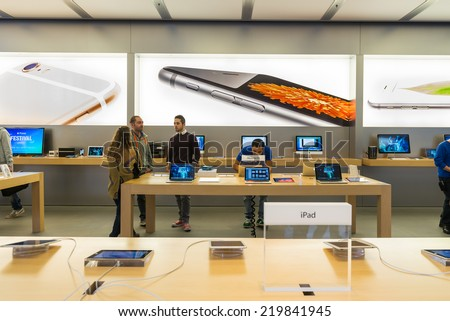 BOLOGNA, ITALY - SEPTEMBER 26 2014: People visiting the Apple Store for the release of new iPhone 6. Pre-orders of the iPhone 6 series exceeded 4 million within its first 24 hours of availability. - stock photo