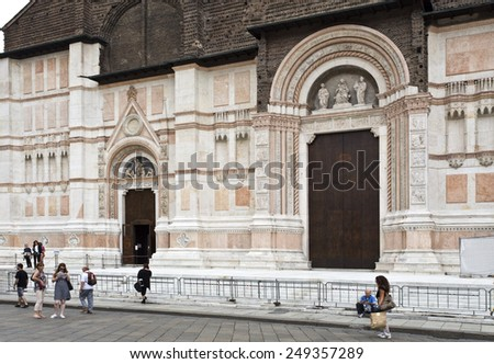 BOLOGNA, ITALY - SEPTEMBER 5, 2014: The Basilica of San Petronio is the main church of Bologna, Italy. Detail of the main entrance. - stock photo