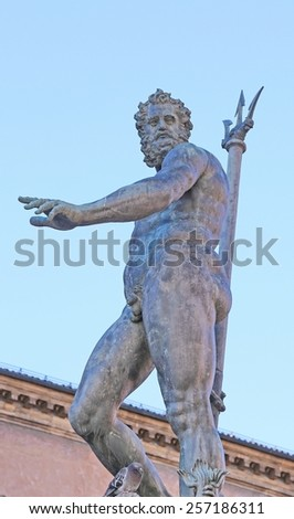 Bologna, Italy, statue of Neptune nude with Trident and a pigeon